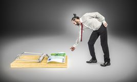 Man and money trap. Long hair businessman and euro mouse trap concept royalty free stock image