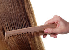 Long hair and comb Royalty Free Stock Images