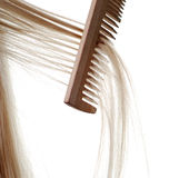 Long hair and comb. Beautiful brown long hair and wood comb Stock Photography