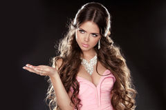 Long Hair. Fashion Beautiful Girl Model with Jewelry isolated on Royalty Free Stock Photos