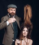 Long hair. Fashion haircut. Hairdresser, beauty salon. Master hairdresser does hairstyle and style. Hairdresser makes. Hairstyle. Barbershop stock photo