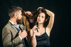 Long hair. Fashion haircut. Hairdresser, beauty salon. Master hairdresser does hairstyle and style. Hairdresser makes. Hairstyle royalty free stock image