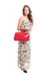 Long hair female model holding a red purse Royalty Free Stock Image