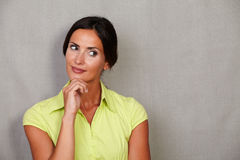 Long hair female thinking with hand on chin Stock Images