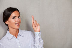 Long hair female wishing and crossing fingers Royalty Free Stock Photos