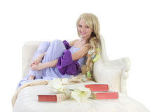 Long hair girl with books. Long hair princess posing on sofa with books Royalty Free Stock Photography