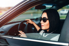 Long hair girl driving car on the road Stock Images