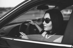 Long hair girl driving car on the road, grain effect. Brunette girl driving car on the road, grain effect stock photo