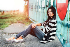 Long hair girl outdoor with old fence behind Stock Images