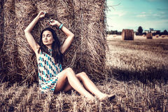 Long hair girl relaxing on the hay stack Royalty Free Stock Image