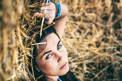 Long hair girl relaxing on the hay stack Royalty Free Stock Photos