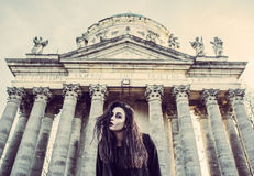 Long hair girl with scary makeup on the old church background Royalty Free Stock Photography