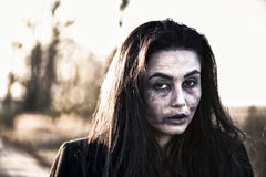 Long hair girl with scary zombie makeup. Long hair girl with scary makeup outdoor royalty free stock photo