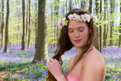 Long hair girl in spring forest royalty free stock image