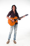 Long hair guy playing guitar acoustic Royalty Free Stock Images