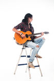 Long hair guy playing guitar acoustic Stock Photos