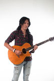 Long hair guy playing guitar acoustic Royalty Free Stock Photo
