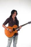 Long hair guy playing guitar acoustic Royalty Free Stock Photo