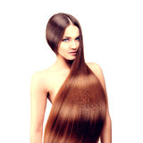 Long hair. Hairstyle. Hair Salon. Fashion model with shiny hair. Royalty Free Stock Images