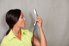 Long hair lady holding phone and screaming Stock Images