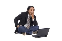 Long Hair Man Frustated with Laptop Stock Images
