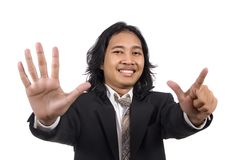 Long hair man give number seven by hand gesture Royalty Free Stock Photography