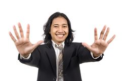 Long hair man give number ten by hand gesture Stock Photography