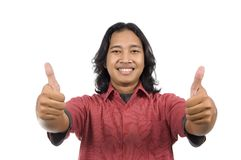 Long hair man give two thumbs Stock Photo