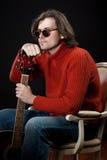 Long hair man with guitar Stock Image