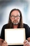Long Hair Man Holding Small Blank White Board Stock Photo