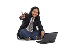 Long hair man working with laptop Royalty Free Stock Photos