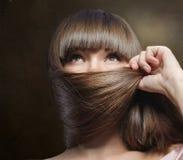 Long hair masking female face Stock Image