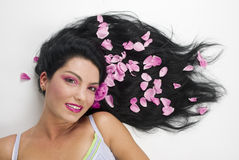 Long hair with pink rose petals stock photos