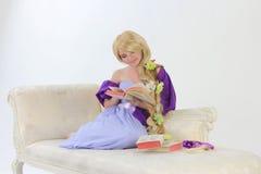 Long hair princess reading Stock Photos