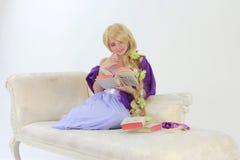 Long hair princess reading Royalty Free Stock Photo