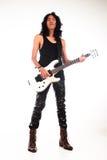Long hair rock n roll guy playing guitar Stock Photo