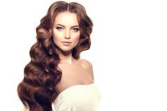 Long hair. Waves Curls Hairstyle. Hair Salon. Updo. Fashion mode Royalty Free Stock Photo