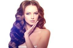 Long hair. Waves Curls Hairstyle. Hair Salon. Updo. Fashion mode Stock Image