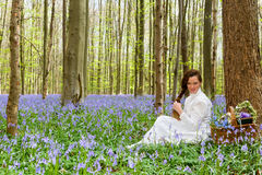Long hair woman in bluebells forest royalty free stock images