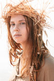 Long Hair Woman in Boho Fashion with Crown of Hay. Close up Young Woman in Boho Style with Dreads Wearing Crown of Hay While Looking at the Camera Stock Photography