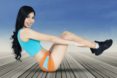 Long hair woman doing sit-up exercise Stock Photo