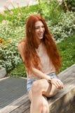 Long Hair Woman At the Garden looking Afar Royalty Free Stock Photos