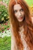 Long Hair Woman At the Garden looking Afar Stock Photo