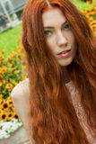 Long Hair Woman At the Garden looking Afar Royalty Free Stock Images