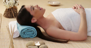 Long Hair Young Woman Lying Down in a Spa Royalty Free Stock Image