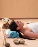 Long Hair Young Woman Lying at the Spa Royalty Free Stock Image