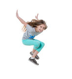 Long-haired active girl dancing, isolated Stock Images