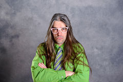 Long haired, angry man in green shirt pink glasses Royalty Free Stock Photos