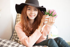 Long haired asia girl happy smile with little flowers Stock Image