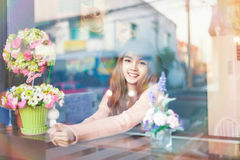 Long haired asia girl happy smile rear mirror reflection Royalty Free Stock Photography